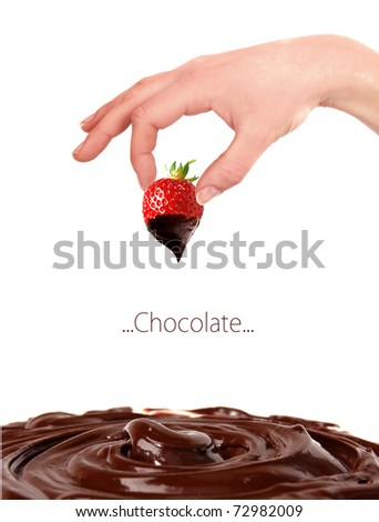 Strawberry dipped in melting dark chocolate with woman hand - stock photo