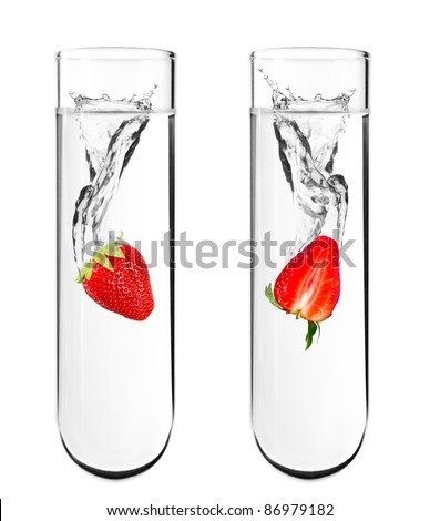 Strawberry dropped in chemical test tube, Biotechnology, Genetically Modified Organisms - stock photo