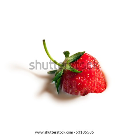 strawberry dropped in yogurt - stock photo