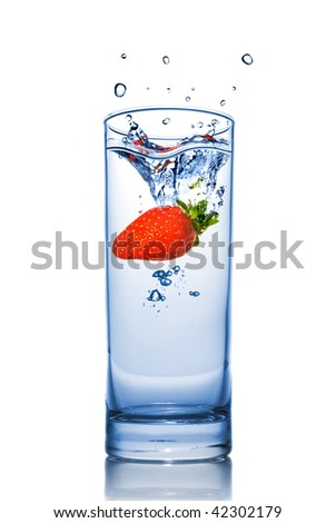 Strawberry dropped into water glass with splash isolated on white - stock photo