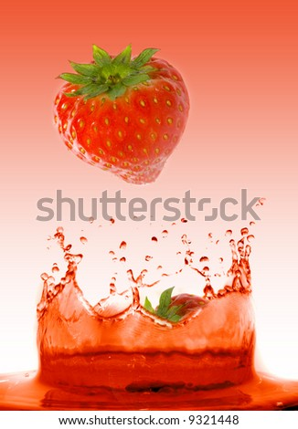 Strawberry falling in juice. Isolation. - stock photo