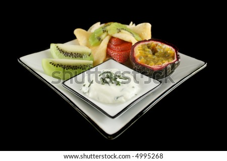 Strawberry filled pancake with passionfruit and minted yogurt. - stock photo