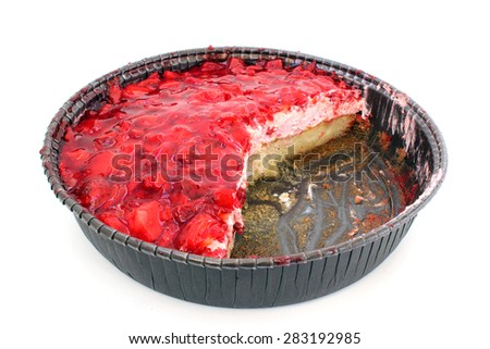 Strawberry flan with cut pieces on a white background - stock photo