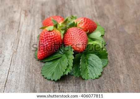 Strawberry. Fresh strawberry, strawberries, Strawberry on a wooden background. Red strawberries, strawberries,strawberries,strawberries  . Strawberry with green leaves. Healthy strawberries. - stock photo