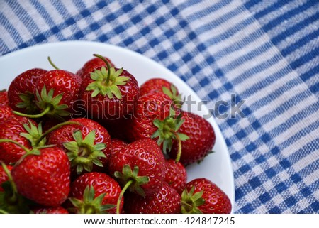 Strawberry from country garden. Fresh strawberries. Organic spring berries. Blue vintage kitchen napkin. Ripe sweet fruit. Healthy eating. Farmland harvest. Food background.