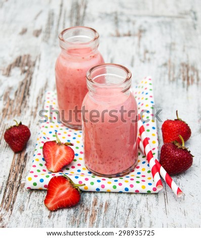 Strawberry fruit smoothies with fresh strawberries on a old wooden background - stock photo
