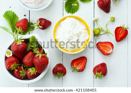 strawberry fruits and whipped cream dessert on white wood table background - stock photo