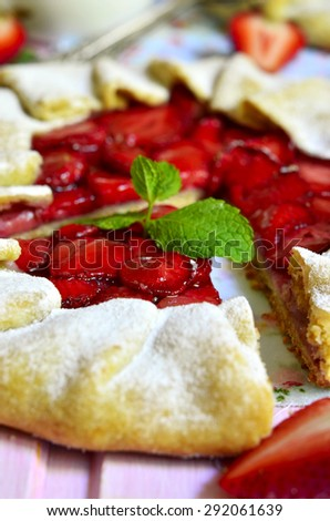 Strawberry galette on rustic background.