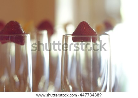 Strawberry Garnish on Cocktail Glasses