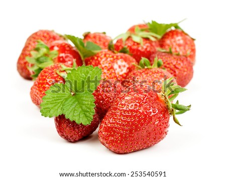 strawberry heap and leaf green on a white background - stock photo