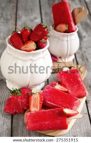 Strawberry homemade ice pops - popsicles - with fresh ripe berries - stock photo