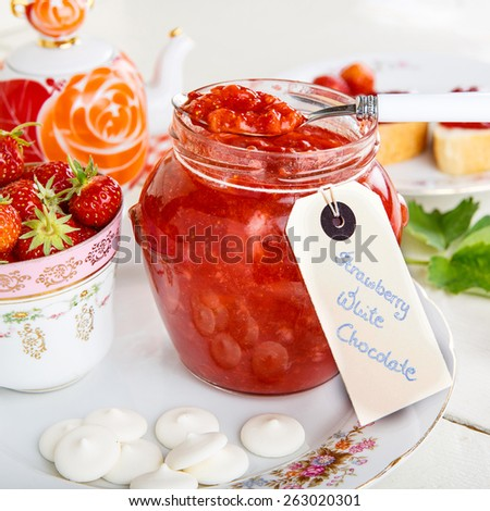 Strawberry homemade jam in jar with white chocolate. healthy organic and vegan food. - stock photo