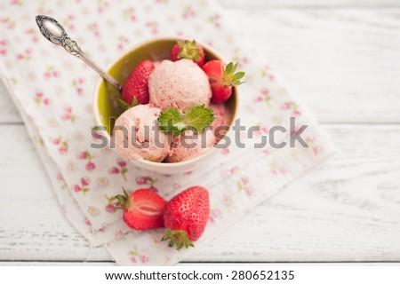 strawberry ice cream on wooden background - stock photo