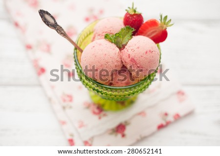 strawberry ice cream on wooden background - stock photo