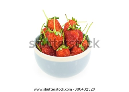 Strawberry in a bowl on white background