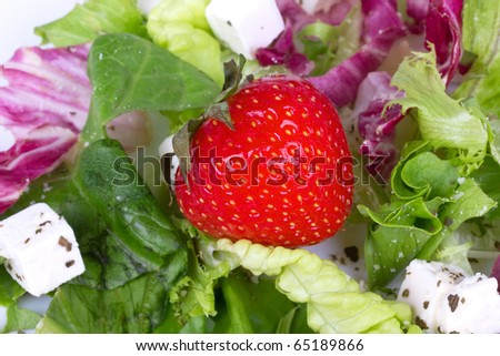 Strawberry in fresh salad, closed-up