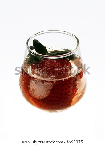 Strawberry in glass and ice
