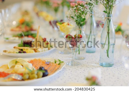 strawberry in glass vase on table - stock photo
