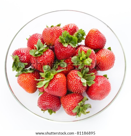 Strawberry in round plate on white background - stock photo