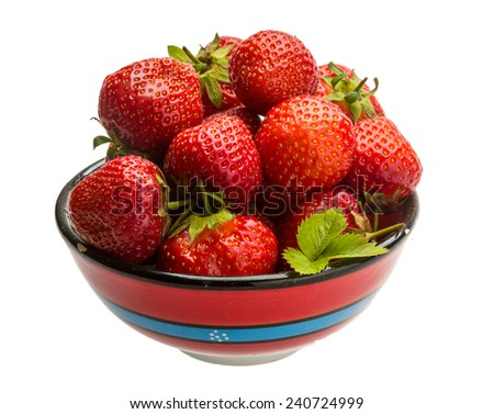 Strawberry in the bowl with leaf - stock photo