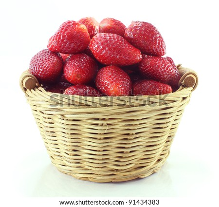 Strawberry in the rattan basket - stock photo