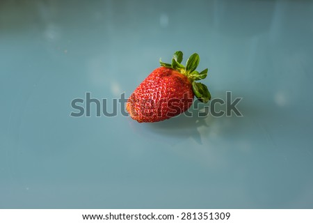 Strawberry isolated on the glass kitchen table background - stock photo