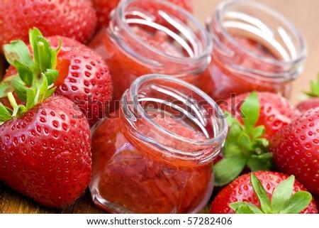 strawberry jam and fresh strawberries - stock photo