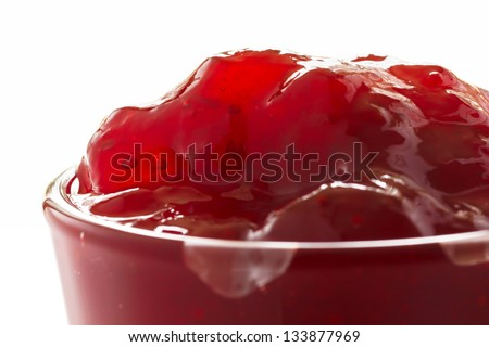 Strawberry jam in glass close up