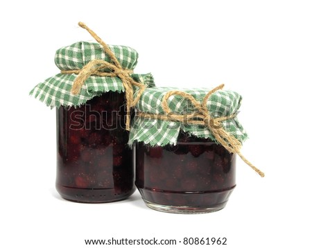strawberry jam in glass jar on white background - stock photo