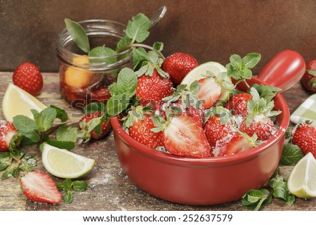 Strawberry jam. Making strawberry jam,  stirring strawberries and sugar and fresh fruits on a background of rustic  wood. Macro, close up - stock photo