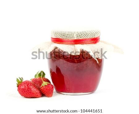 Strawberry jam on white - stock photo