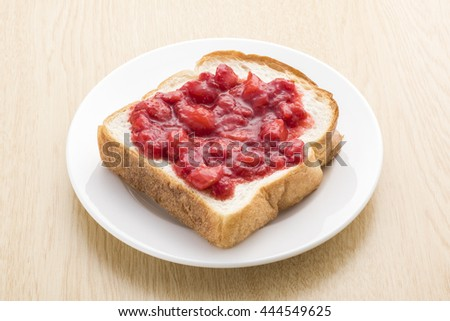 Strawberry jam painted in bread