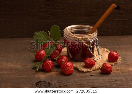 Strawberry jam with fresh strawberries - stock photo