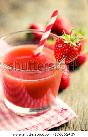 strawberry juice in glass. retro filter - stock photo