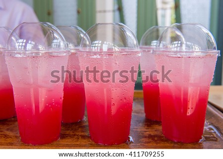 Strawberry juice with soda Soft drinks in plastic cups. - stock photo