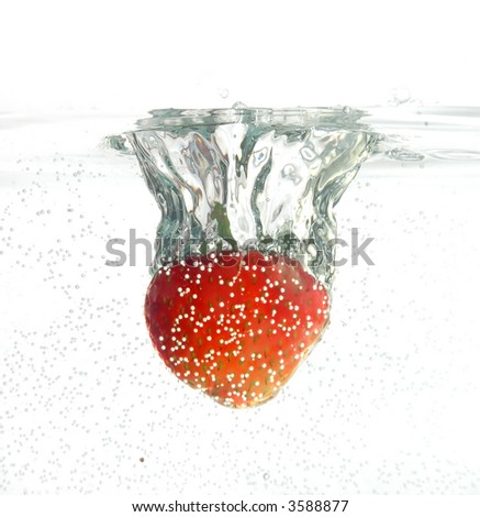 Strawberry jumping into water - stock photo