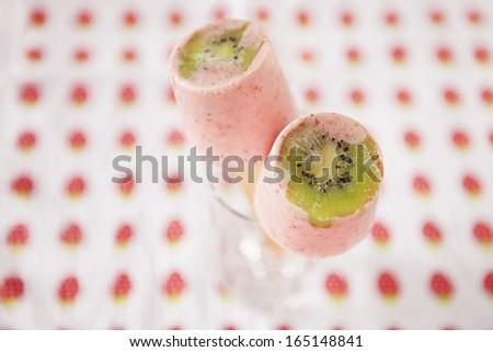 Strawberry-Kiwi Yogurt Freezer Pops, frozen homemade popsicles on a stick dessert - stock photo