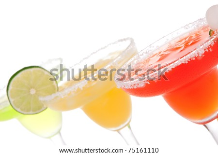 Strawberry, lime, apple Margaritas cocktails composition decorated with twisted lime, mint, cherry, cocktail umbrella in margarita glass isolated on a white background - stock photo