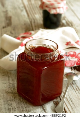 strawberry marmalade in glass on wooden - stock photo