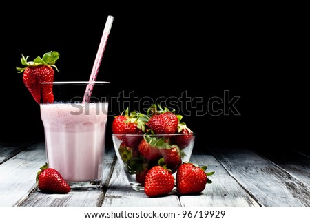 strawberry milkshake with whole strawberry on side - stock photo