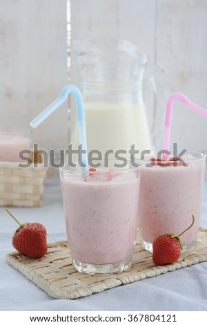 Strawberry milkshakes blended with berries - stock photo
