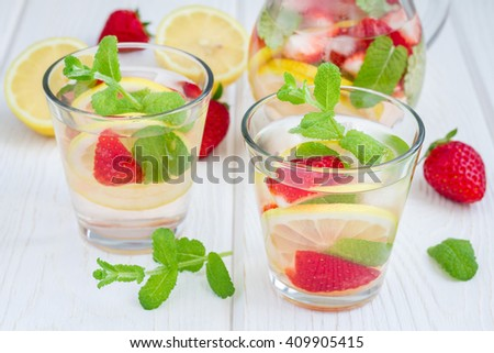 Strawberry mint homemade lemonade on white wooden table