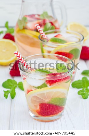 Strawberry mint homemade lemonade on white wooden table - stock photo
