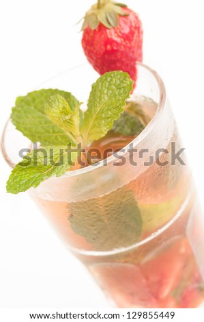 Strawberry Mojito cocktail, a Cuban cocktail made with cuban rum, lime, sugar, a splash of soda and flavoured with fresh strawberry juice - stock photo
