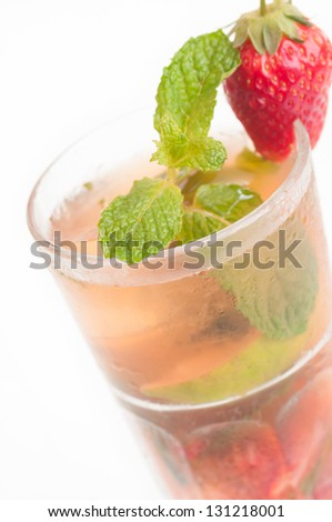 Strawberry Mojito cocktail extreme close up, a Cuban cocktail made with cuban rum, lime, sugar, a splash of soda and flavoured with fresh strawberry fruit - stock photo