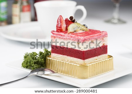 Strawberry Mousse Cake on the white Plate - stock photo