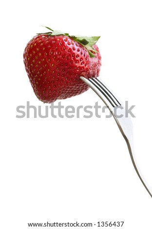 Strawberry on fork isolated on white - stock photo