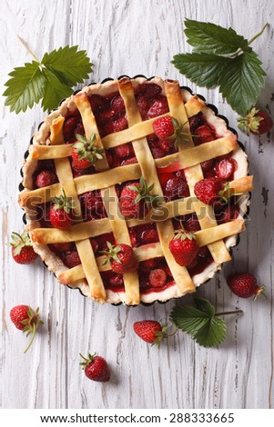 Strawberry pie with fresh berries in a baking dish. vertical top view - stock photo