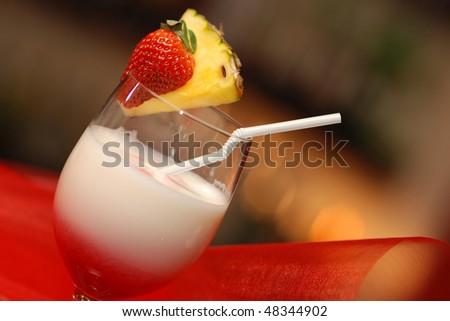 Strawberry Pina Colada made of rum, coconut, cream - stock photo