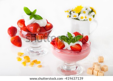 Strawberry pudding with fresh strawberries, mint leaves and raisins - stock photo